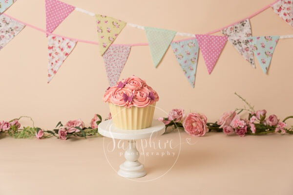 Giant cupcake cake smash session pink flowers bunting birthday photo Samphire sussex