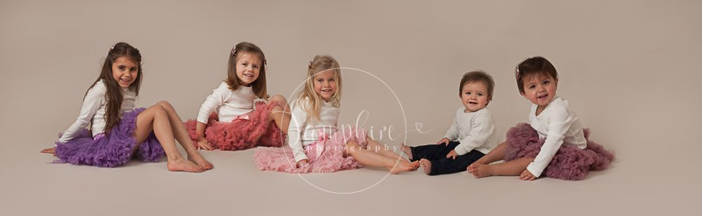 Samphire-Photography-Studio-Portraits-photo-group-siblings-family-smiles-sitting-tutu-purple-pink-Horsham-Sussex