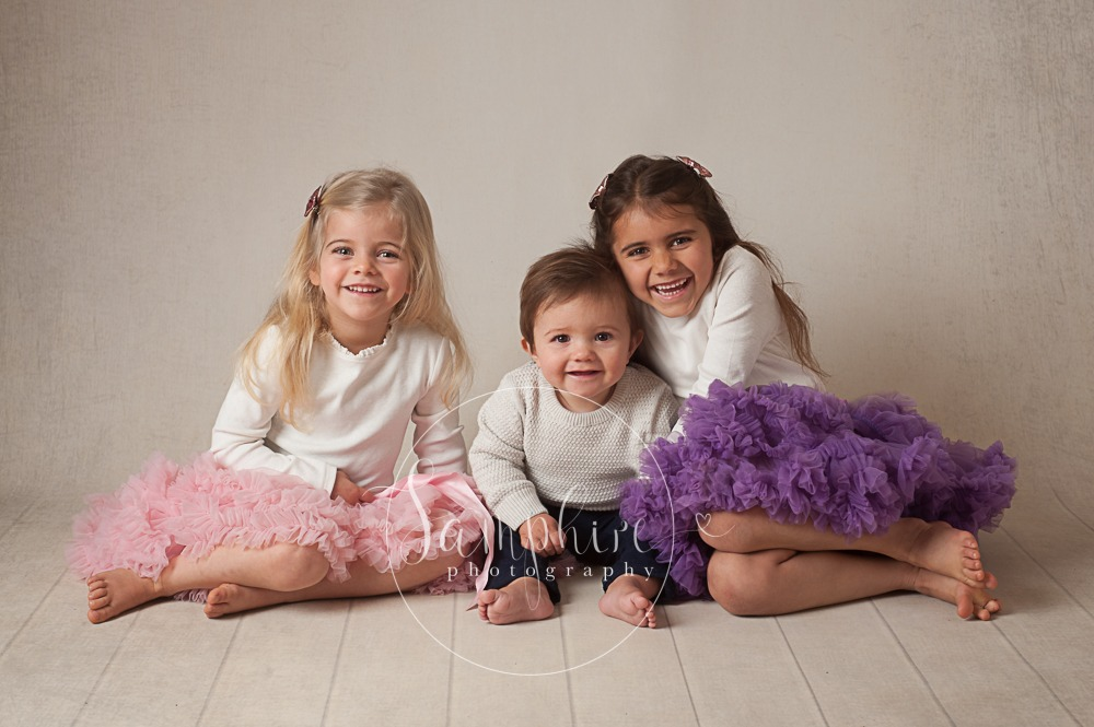 Samphire Photography studio portrait photo siblings family smiles tutu purple pink Sussex