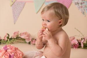 Cake Smash eating cake chocolate pink bunting photo sussex