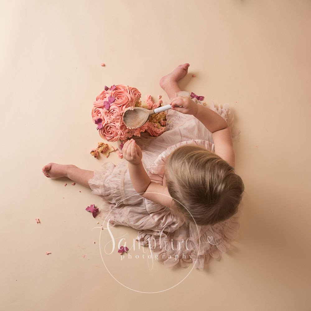 cake smash session images above spoon pink sussex photo
