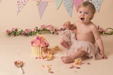 Cake Smash Cupcake butterflies flowers pink bunting photo sussex