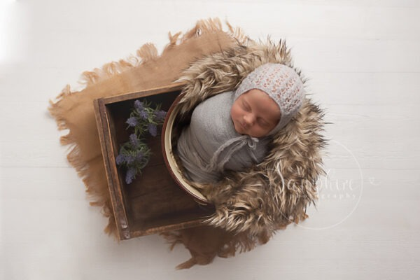 experienced newborn photographer haywards heath sussex prop bonnet