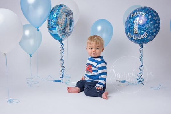 studio first birthday portraits baby boy happy milestone balloons by Samphire Photography Horsham Sussex