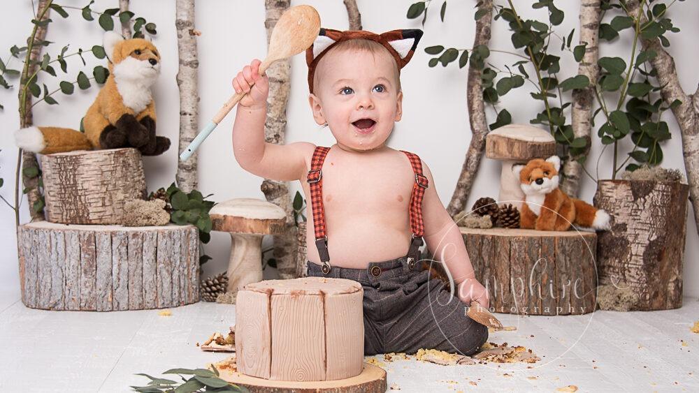 Samphire Photography bespoke woodland theme fox cake smash Sussex Horsham Brighton happy