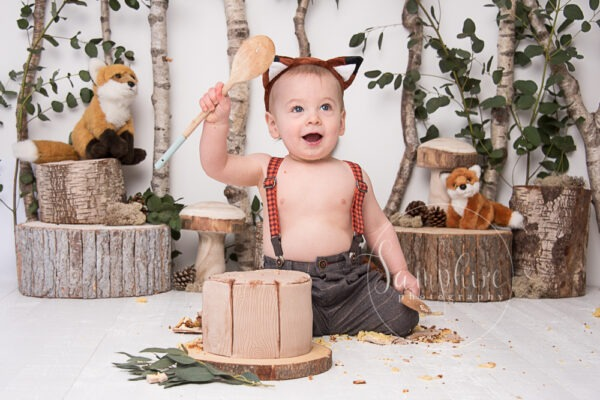 Samphire Photography bespoke woodland theme fox cake smash Sussex Horsham Brighton happy