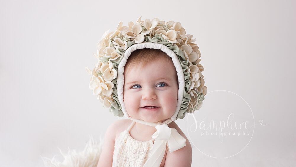 floral bonnet ivory sage Samphire photography horsham babies sitter sessions baby portraits Brighton sussex