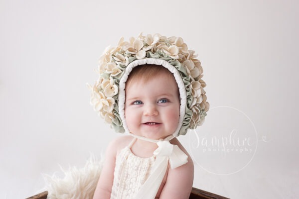floral bonnet ivory sage Samphire photography horsham babies sitter sessions baby portraits Brighton sussex
