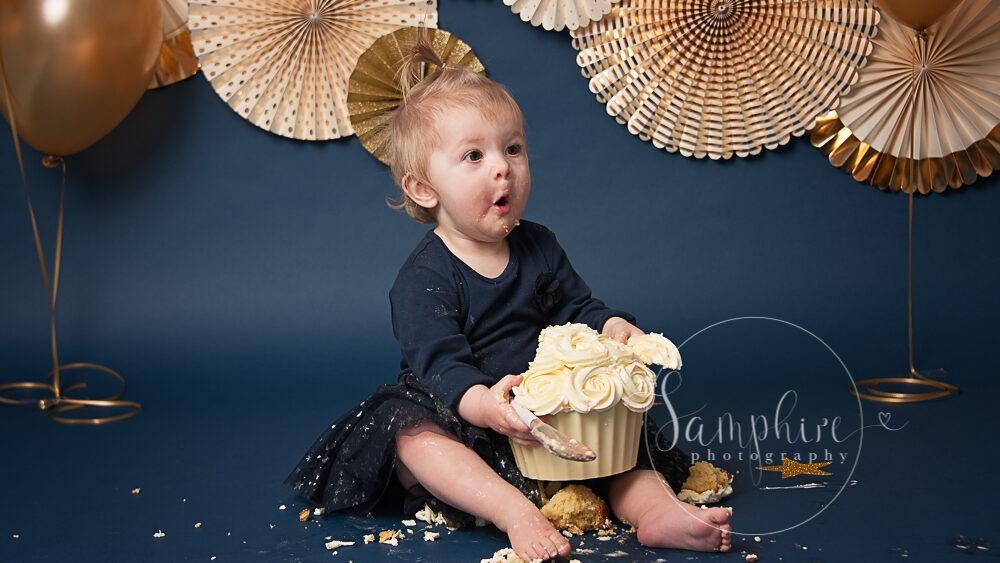 Little girl enjoying her bespoke cake smash sussex