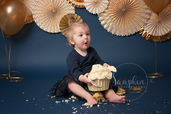 Little girl enjoying her bespoke cake smash sussex