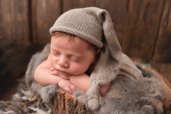 newborn photographer sussex baby boy neutral natural browns knits fur wood by Samphire Photography