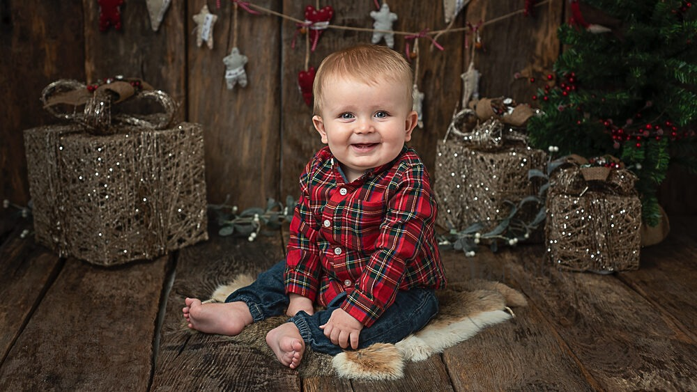 Festive Christmas portrait for this little boy by Samphire Photography based near Horsham