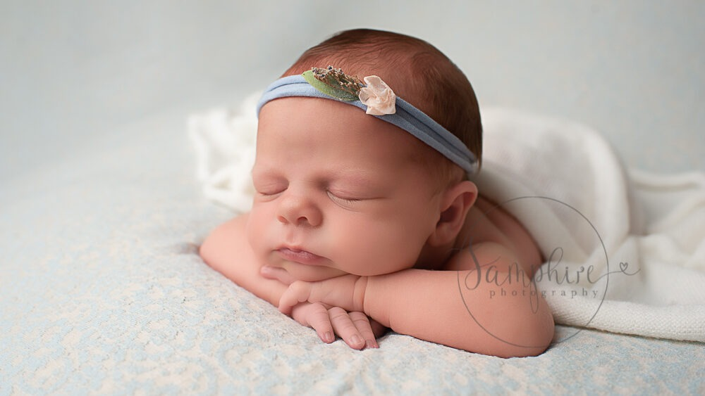 experienced newborn photographer sussex sleeping girl blue headband Samphire Photography