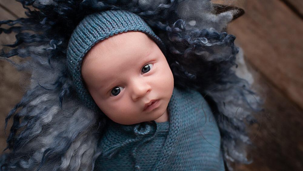 West Sussex Newborn Photographer baby boy awake in blue by Samphire Photography Horsham