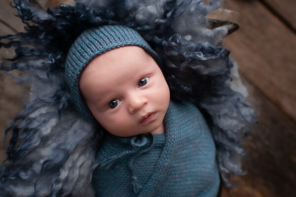 West Sussex Newborn Photographer baby boy awake in blue by Samphire Photography Horsham