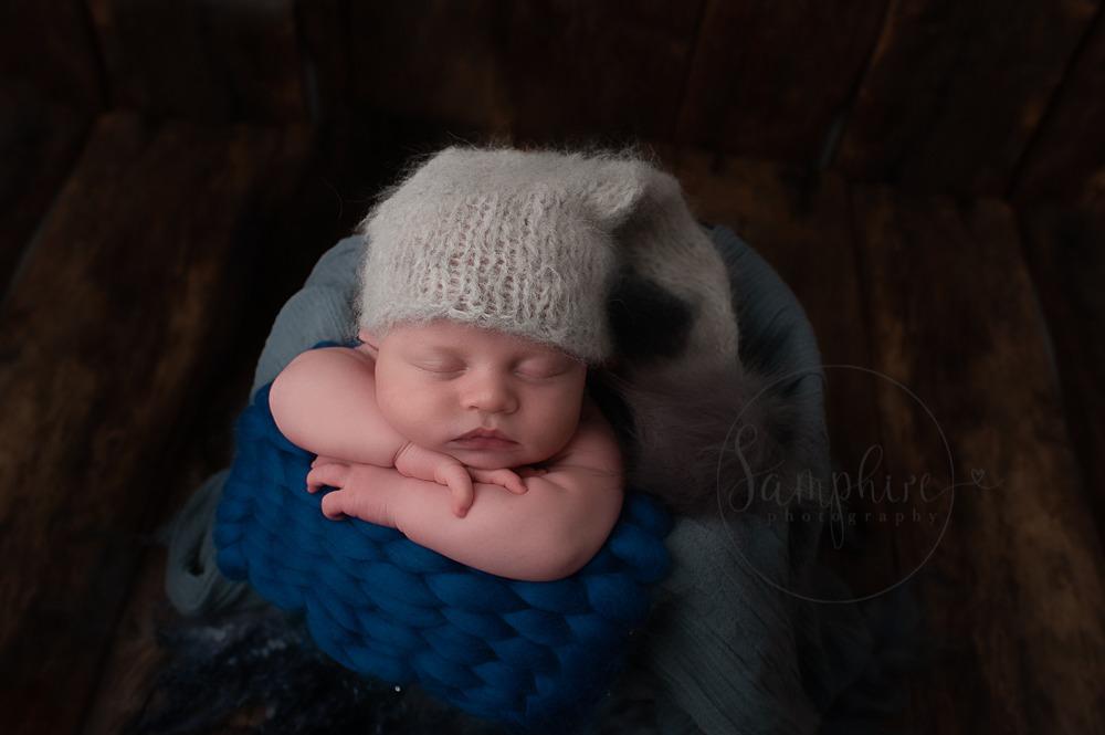 West Sussex Newborn Photographer baby boy in blue knits by Samphire Photography Horsham