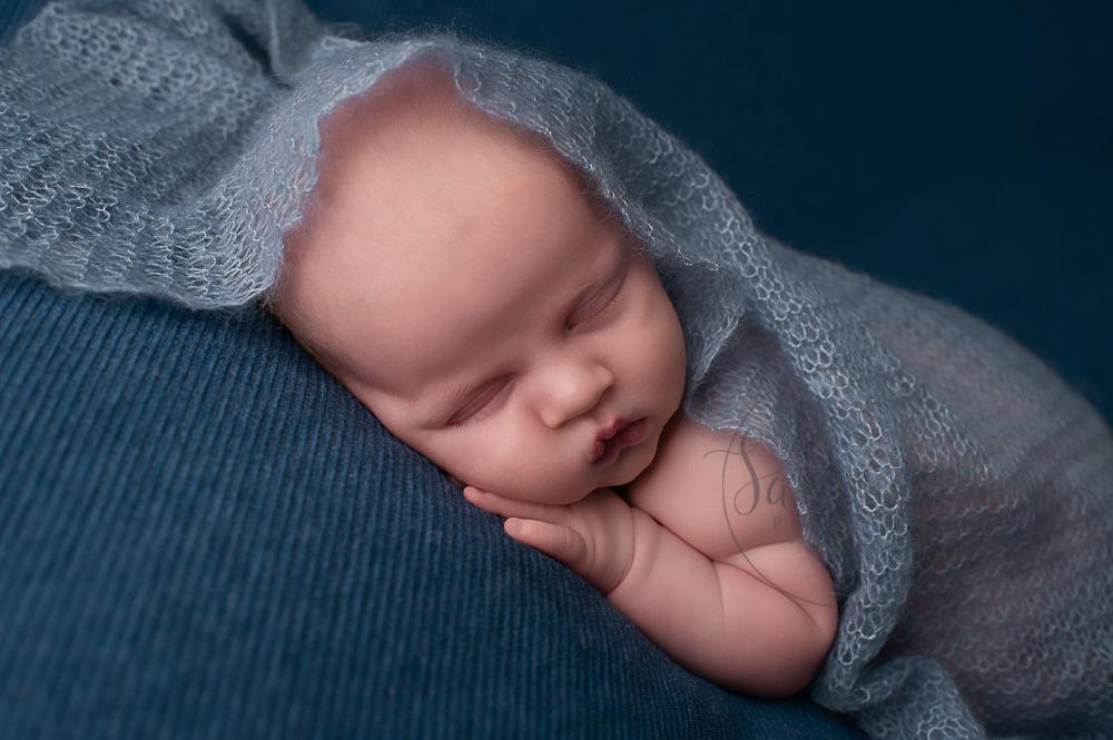 West Sussex Newborn Photographer baby boy in blue layers by Samphire Photography Horsham