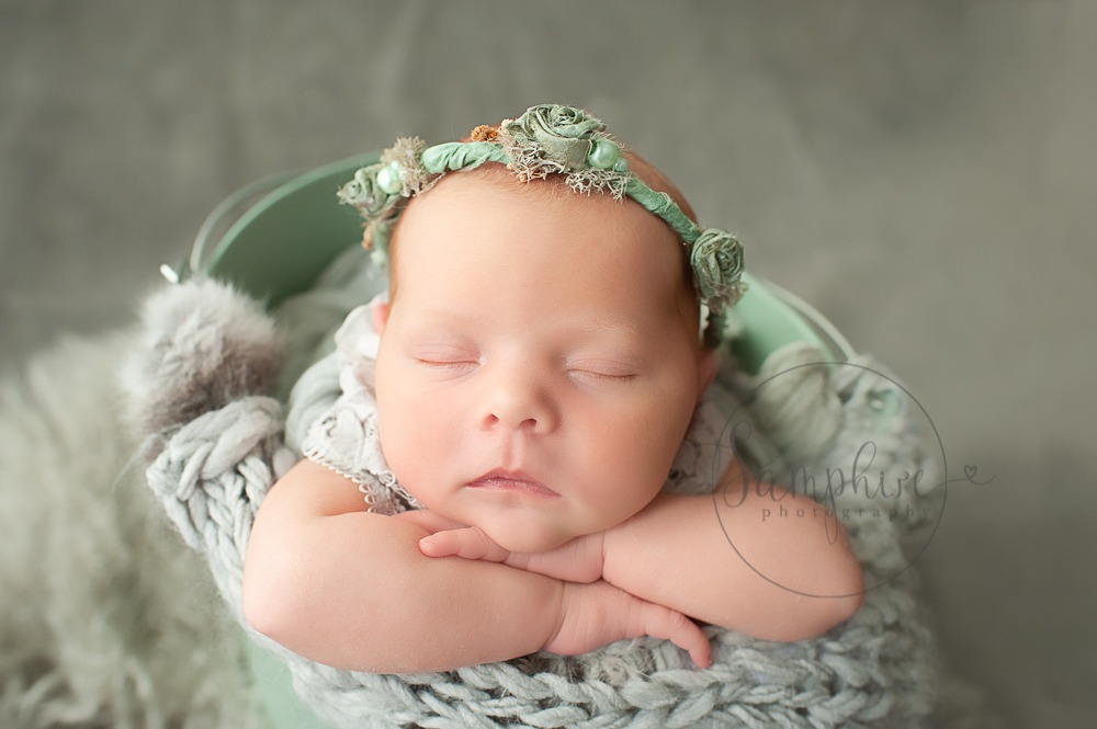 newborn baby photographs Sussex floral headband green knit studio portraits by Samphire Photography