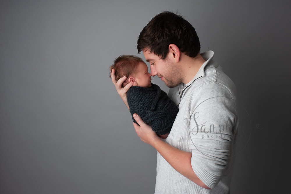 Experienced newborn photographer West Sussex father baby boy studio portrait Samphire Photography