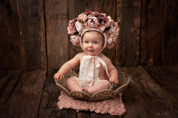 Baby Milestone Photographer West Sussex cute sitter girl bonnet Samphire Photography