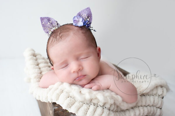 Sussex newborn baby pictures sleeping girl purple kitten ears headband Samphire Photography