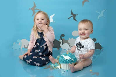 dino cake smash and splash birthday boy blue white siblings Samphire Photography