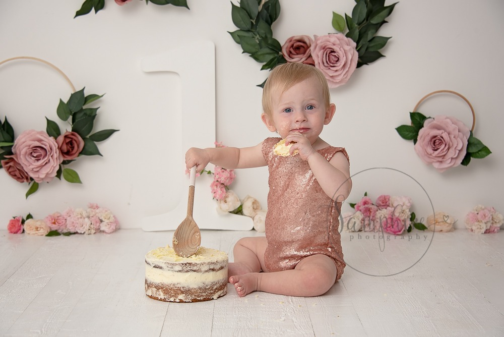 Baby's first year cake smash portraits pink floral Samphire Photography Sussex