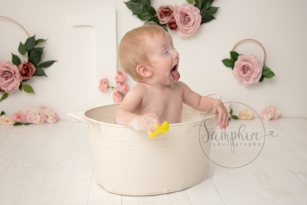 Baby's first year cake smash portraits pink floral bathtime Samphire Photography Sussex