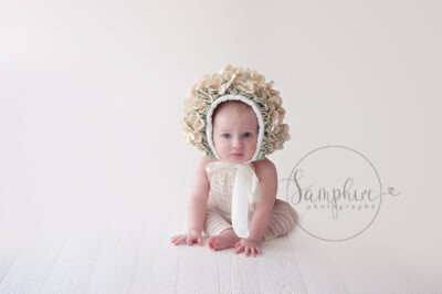 Baby's first year milestone portraits cream floral bonnet Samphire Photography Sussex