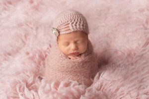 Baby's first year newborn portraits pink hat Samphire Photography Sussex