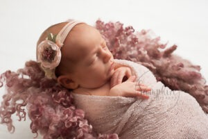 Baby's first year newborn portraits pink floral headband Samphire Photography Sussex