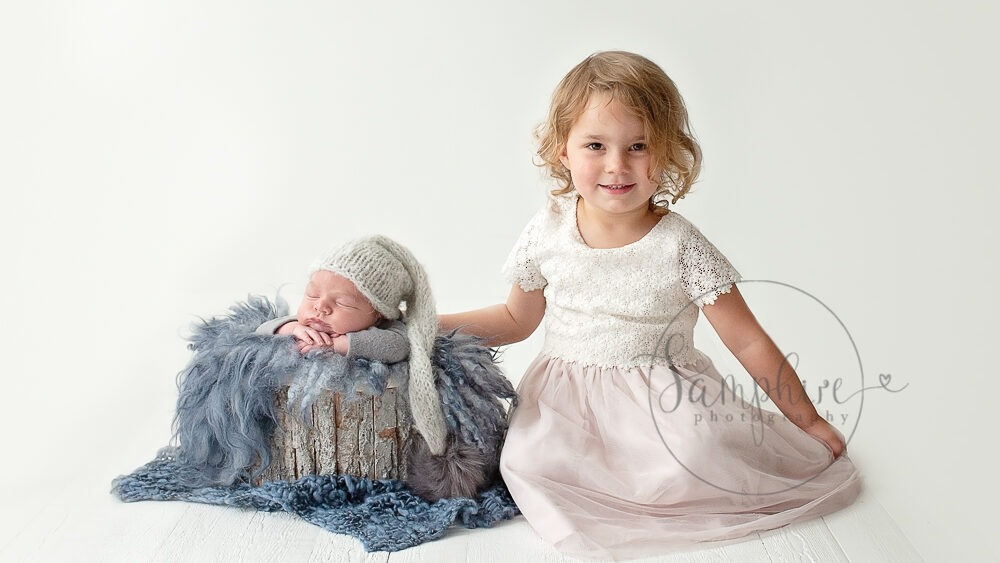 Newborn photographs with older sibling blue grey studio portrait Samphire Photography Sussex