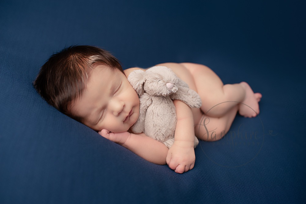 New baby portraits West Sussex blue background bunny Samphire Photography