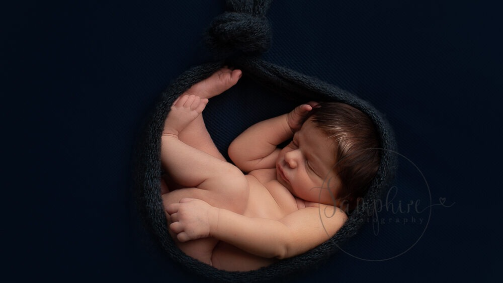 New baby portraits West Sussex blue background Samphire Photography