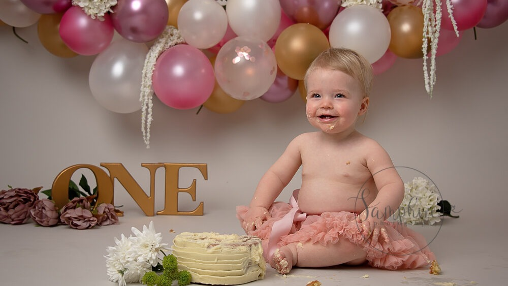 Samphire Photography pink gold Cake Smash with Sibling Horsham
