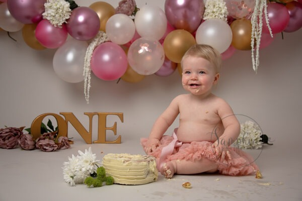 Samphire Photography pink gold Cake Smash with Sibling Horsham