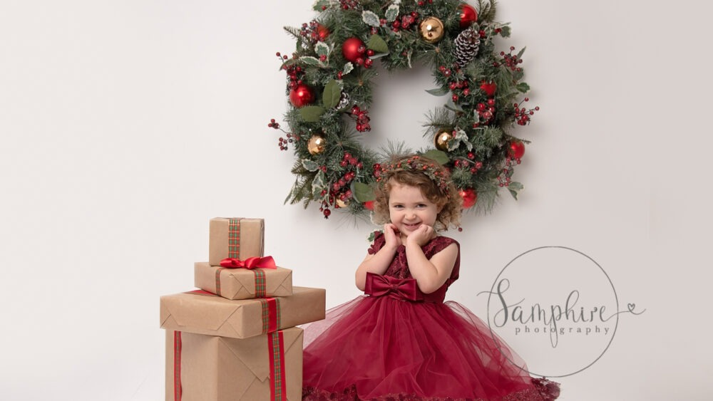 Christmas Portraits Sussex girl classy christmas colour wreath presents west sussex