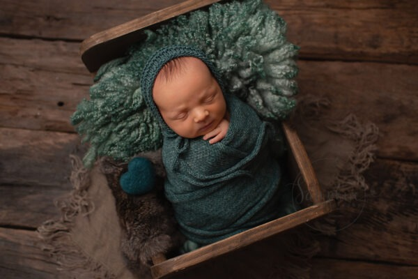 sleeping Newborn wrapped in green by Samphire Photography Sussex newborn mini session