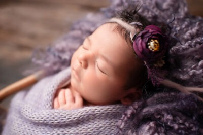 newborn mini session sleeping Newborn wrapped in lilac by Samphire Photography Sussex