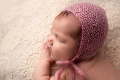 newborn baby shoot studio portrait pink bonnet