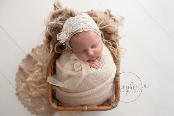 newborn photoshoot sussex cream bonnet